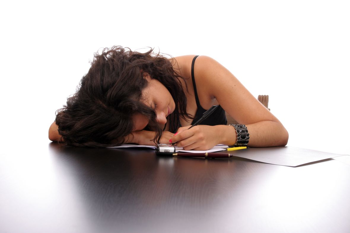 young business woman sleeping on the desk
