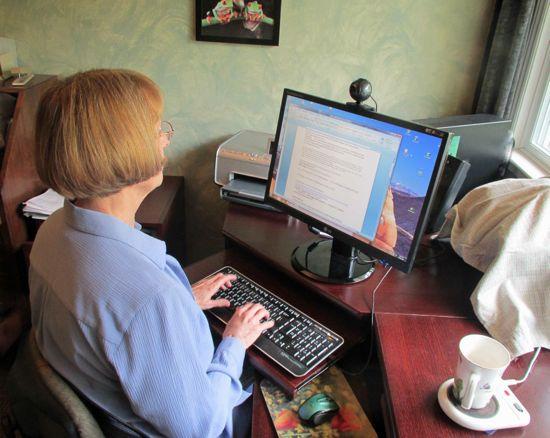 Cinda writing with her slippery elm tea.