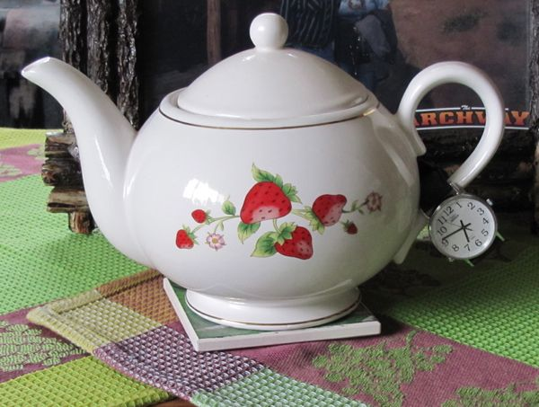 My grandma's favorite teapot with her watch on the handle.