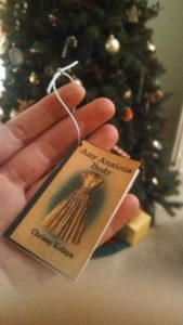 A Christmas ornament my mom made me to celebrate my first book (She even included the blurbs and a wee little ISBN!)