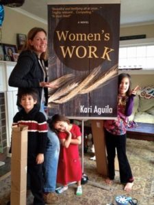 The day the banner for Women's Work arrived! Our kids approve!