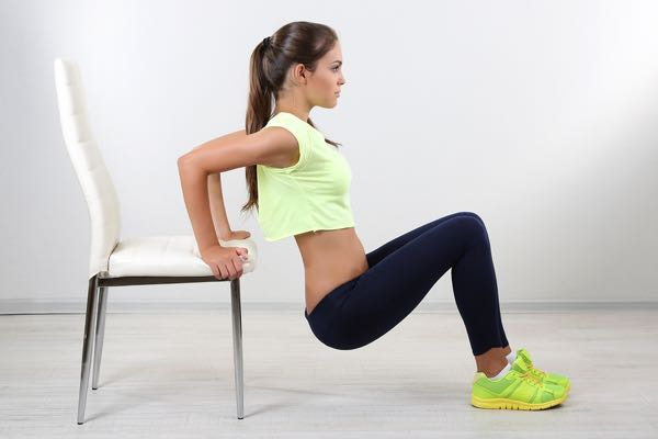 Use your chair to strengthen your arms. You can remain seated and just press up, or come forward to press up and down.