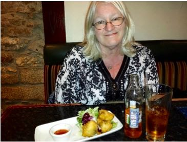 Research is critical for authors. Here I am in Inverness, trying Haggis balls. I'll let you guess if I liked it or not.